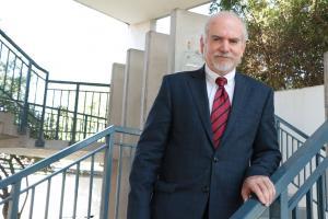 Dr Cristian Parker